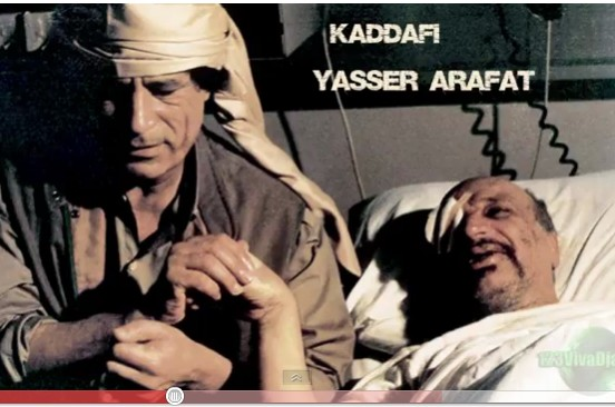 Gadhafi holds the hand of wounded Arafat