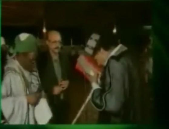 Muammar kisses Koran