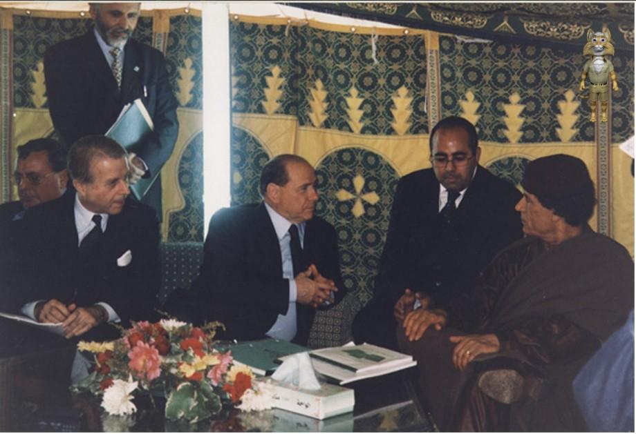 Mu w Berlusconi's enourage in his tent