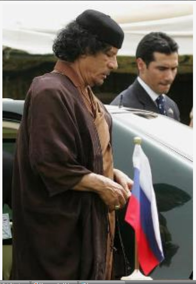 Muammar with his prayer beads at time of Putin