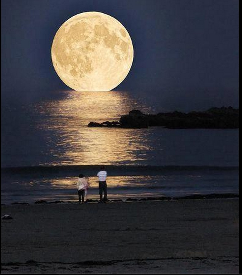 Large moon at Water's edge