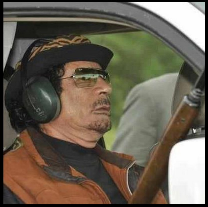Mu in car w his Rifle