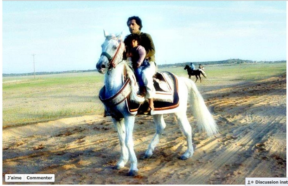 Mu and his child via horseback