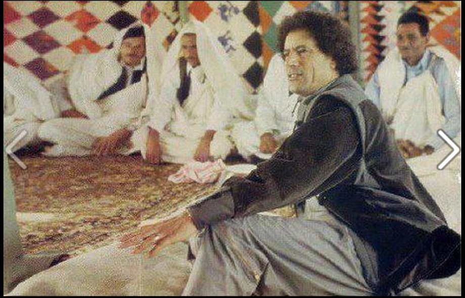 Mu gives a lectures on floor of tent