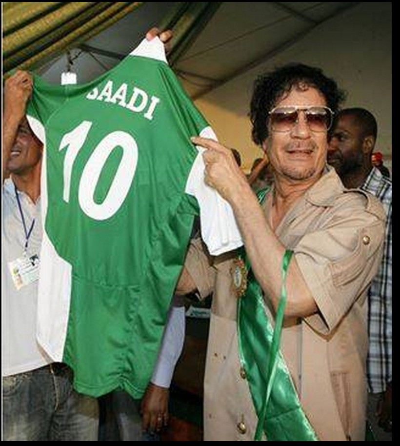 Mu holds up SAADI's winning Soccer shirt