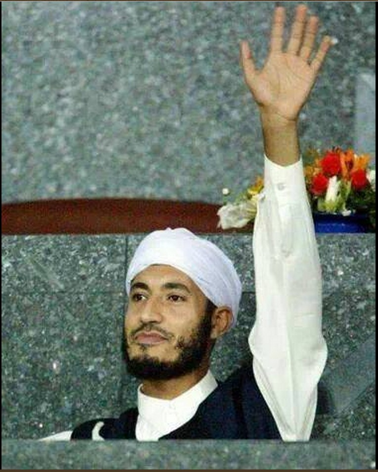 SAADI left hand up in pledge