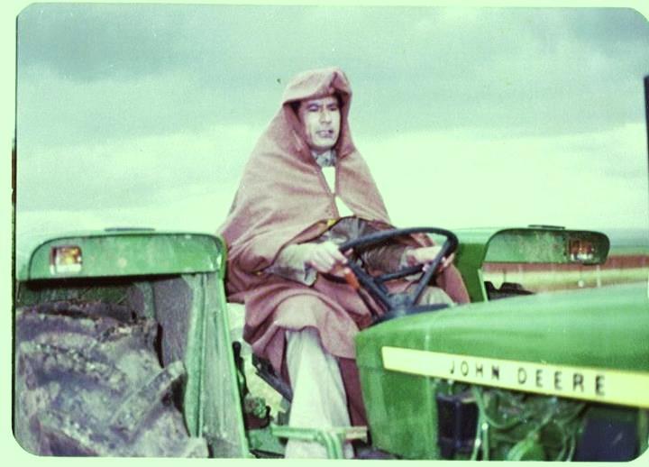 Muammar on John Deere tractor