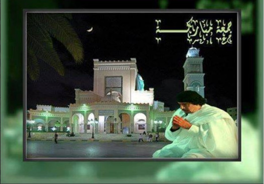 Mu kneels before the Great al-Asmar MOSQUE in ZLITEN