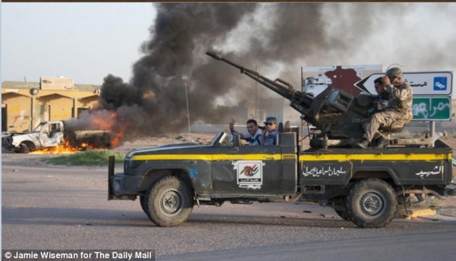 The Libyan Shield of Nuri Bushmin arrows invading BANI WALID