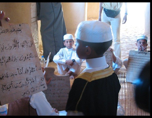 Boy studies Holy Quran in Awjilah