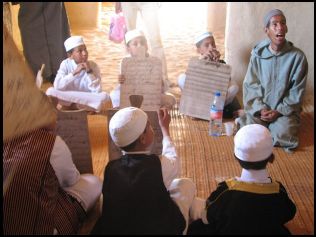 Boys studying in the old Al-Kabir mosque in AWJILAH