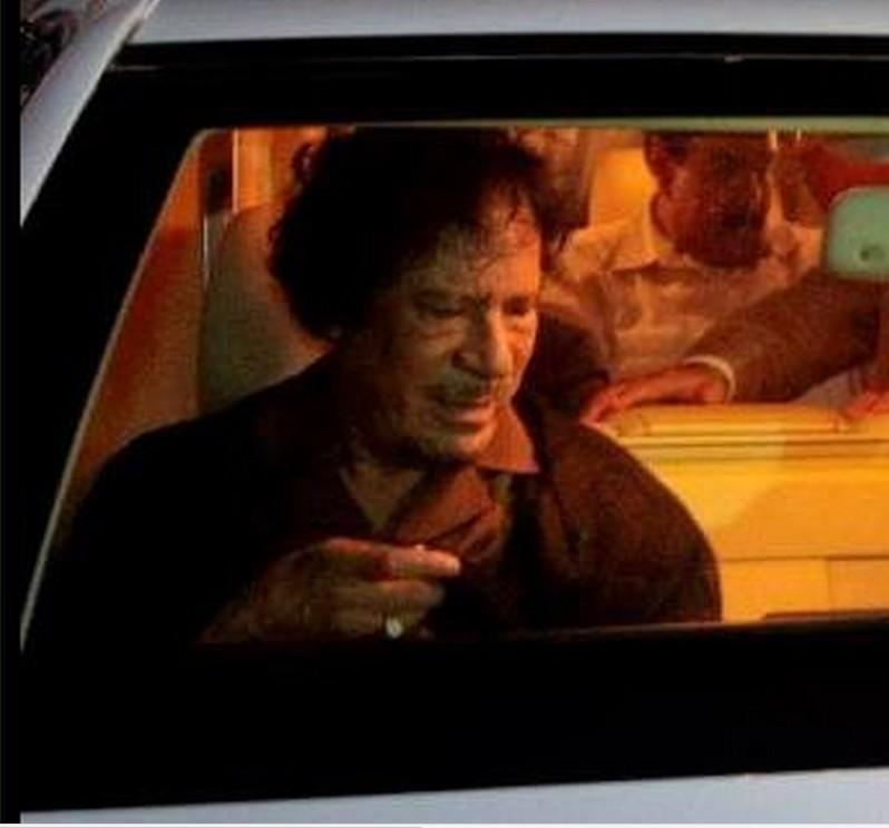 Mu seated in his car