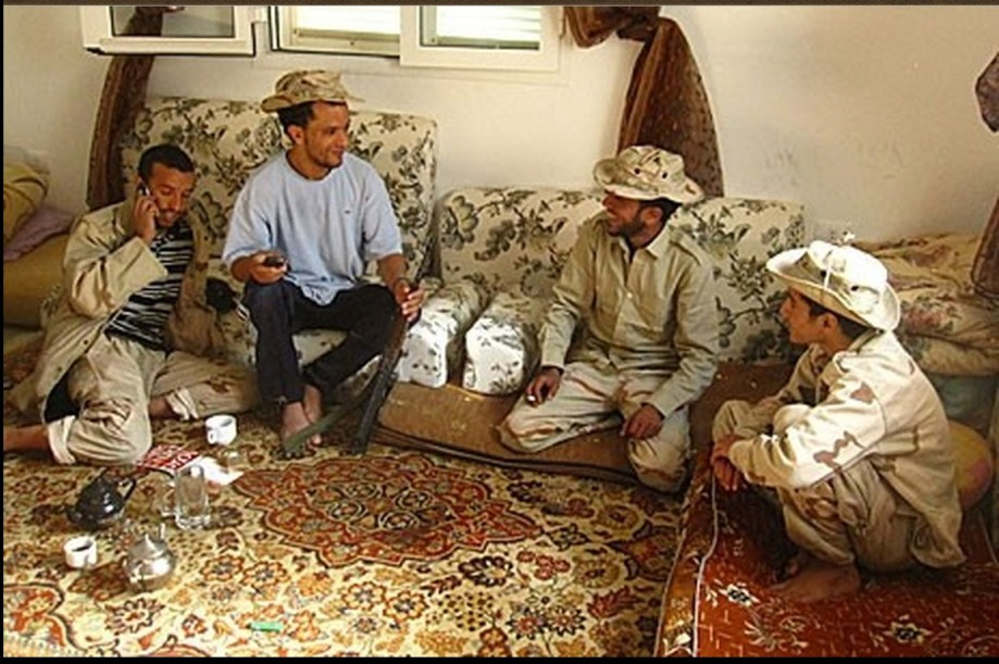 Abdelhakim Erassi, second from right, relaxes with fellow Brigademen from the mountains of Zintan