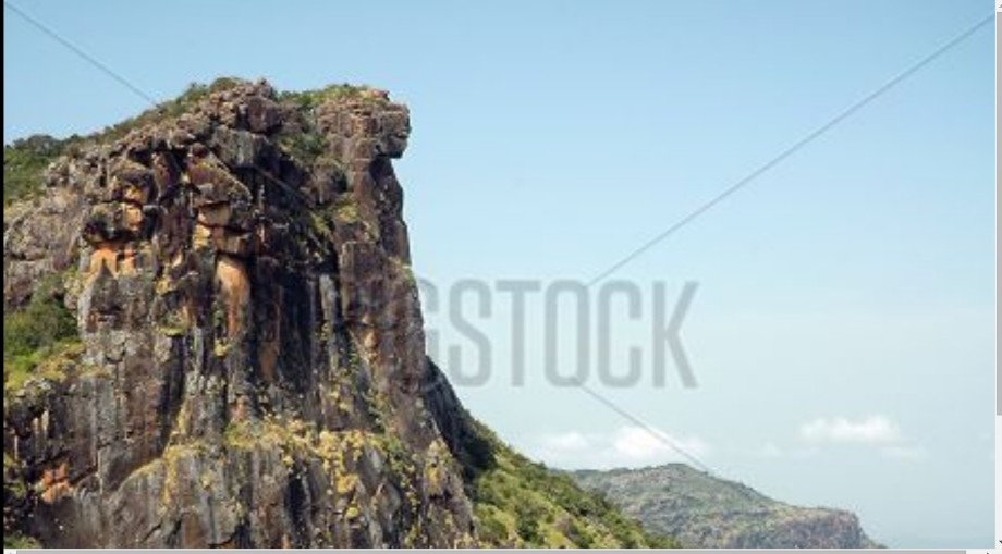 carved African woman on mountain in Guinea
