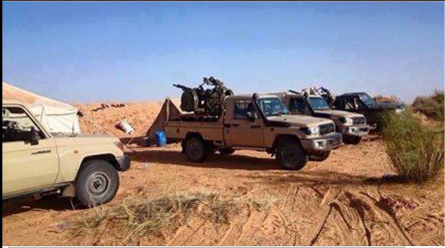 LIBYAN ARMY on the south outskirts of  corner, 1