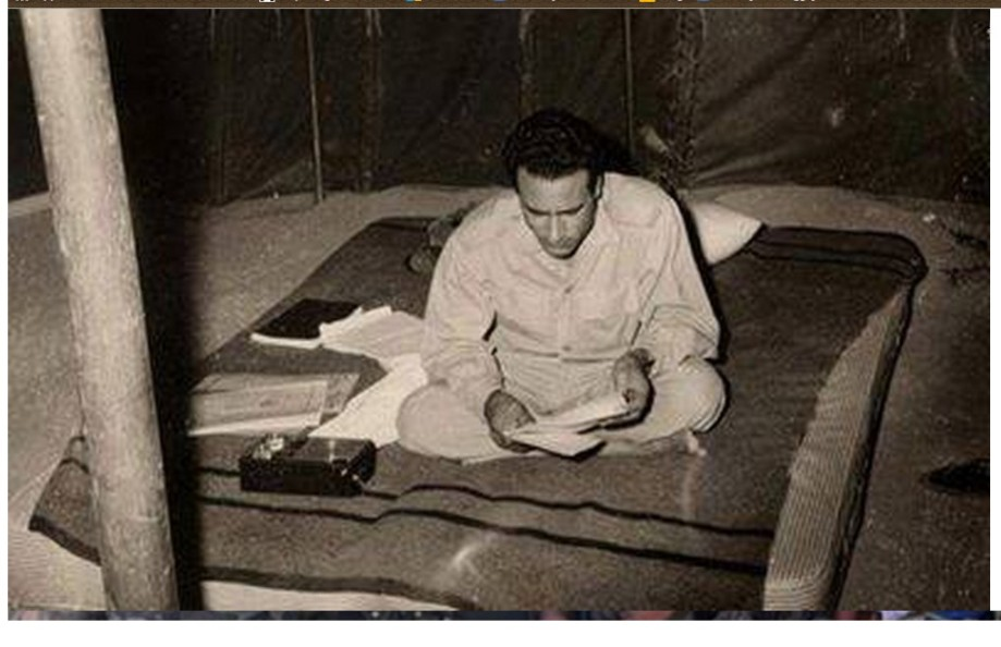 Mu studies in his tent on a mat