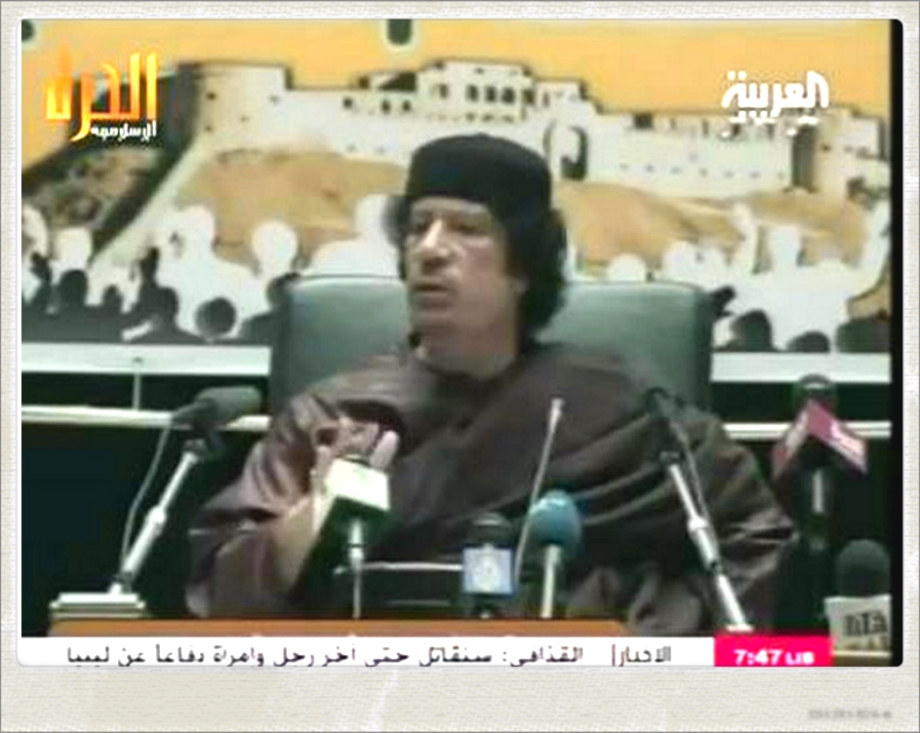 Mu'ammar al-Qathafi addressing the Arab League