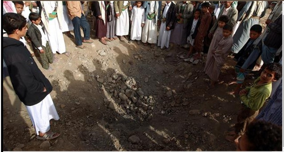 crater left following an airstrike on March 28, 2015 in Sana'a on the third day of the Saudi-led airstrikes against Yemen
