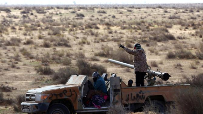 Fighters from the Fajr Libya militia prepare to fire an anti-tank cannon ...