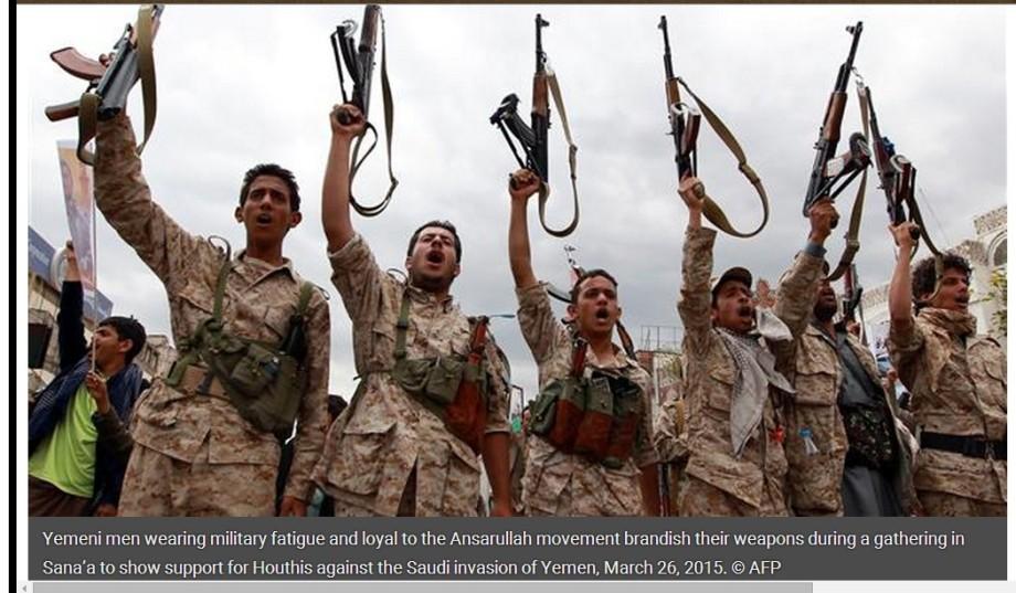 Yemeni men wearing military fatigue and loyal to the Ansarullah movement