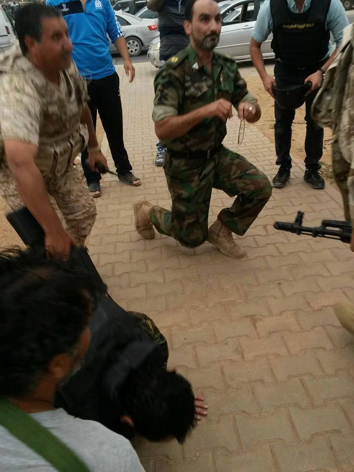Mohammaed al-Hajazi (el-Hassy) prays with the young Libyan Army in Benghazi