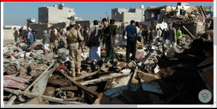 Yemen's Houthi Ansarullah fighters inspect the damage at the scene of Saudi airstrikes near the airport in the capital, Sana'a, on 26 March 2015