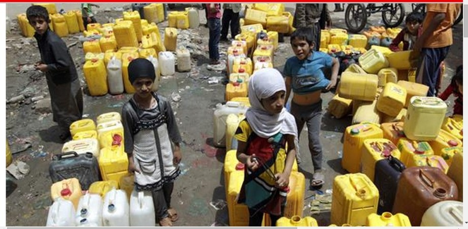 Yemeni children wait to fill their jerrycans with water from a public tap amid an acute shortage of water supplies to houses in the capital, Sana'a, due to the ongoing Saudi airstrikes in the country, April 26, 2015