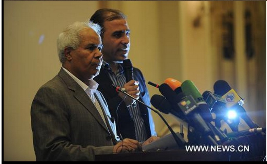 Captive hero Mohammed Abdul Qasim (cabled), Secretary of the 'General People's Conference' w Moussa Ibrahim