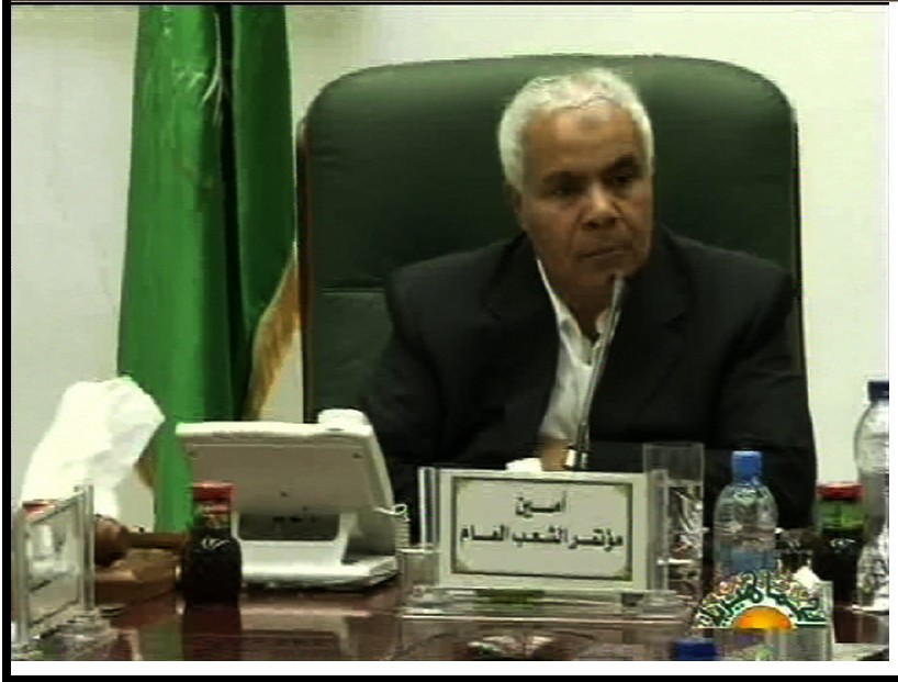 Captive hero Mohammed Abdul Qasim (cabled), Secretary of the 'General People's Conference'
