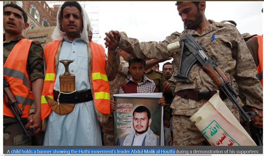 child holds a banner showing the Huthi movement's leader Abdul-Malik al-Houthi, in South Yemen demonstration
