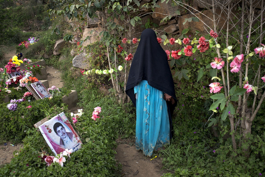 A young girl visit the martyrs cemetery in Marran, Saada, March 27, 2014.