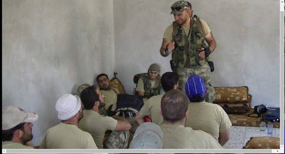 LIBYA's Tripoli 'mayor' el-MAHDI HARATINE training insurrectionists, in Syria