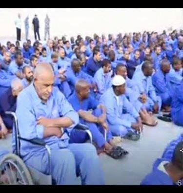 'Colonel Mamed bin nail' sits upon a chair at MISURATA prison