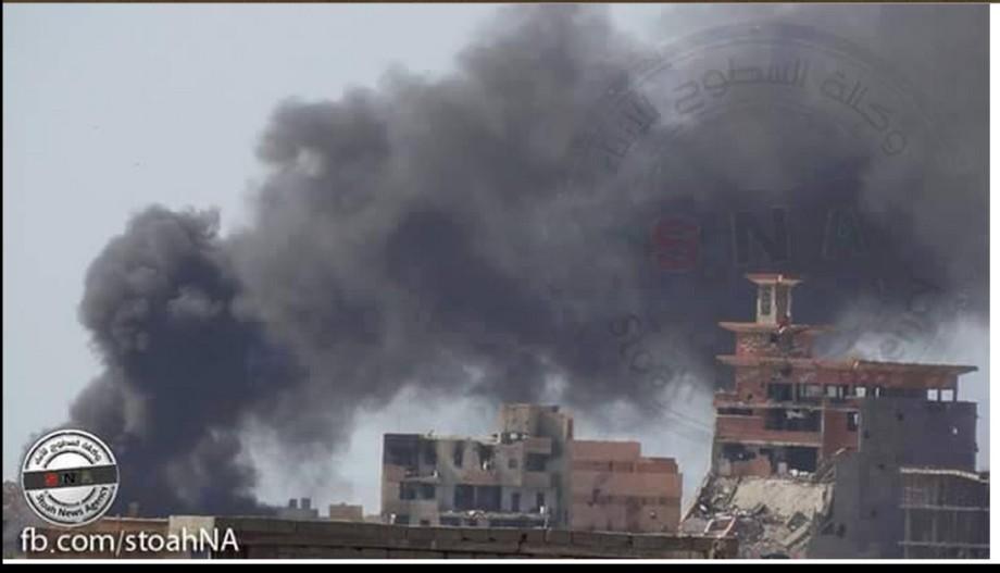 Libyan airforce warplanes targeting the bulldozer at al-Sabri warf, Benghazi