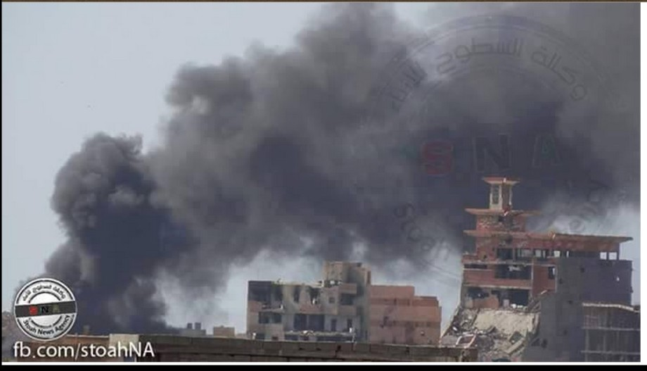 Libyan airforce warplanes targeting the bulldozer at al-Sabri warf, Benghazi