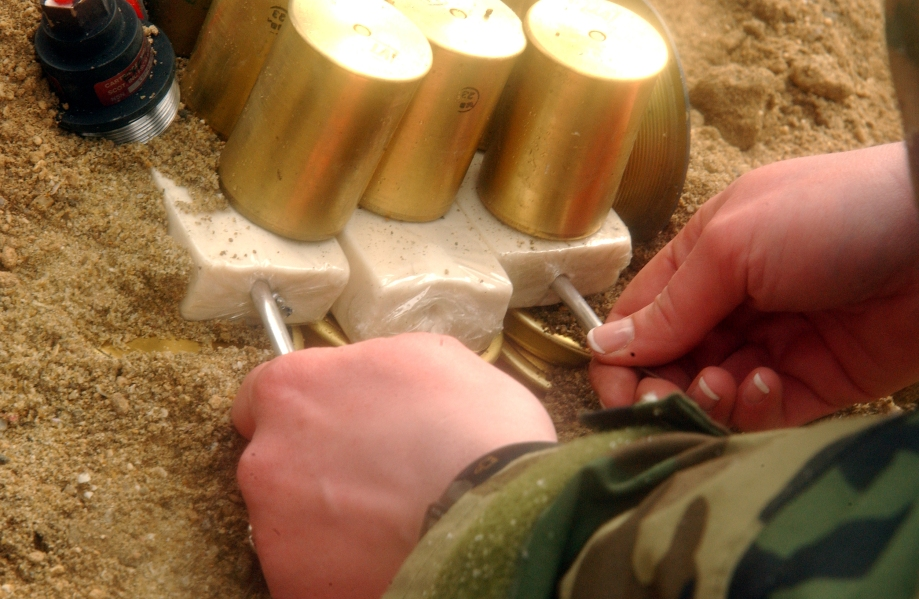 PFC Laura Mellinger, Headquarters and Headquarters Squadron,  aircraft rescue fire fighting crew member, inserts blasting caps into blocks of C-4 at Target Island Feb. 1.