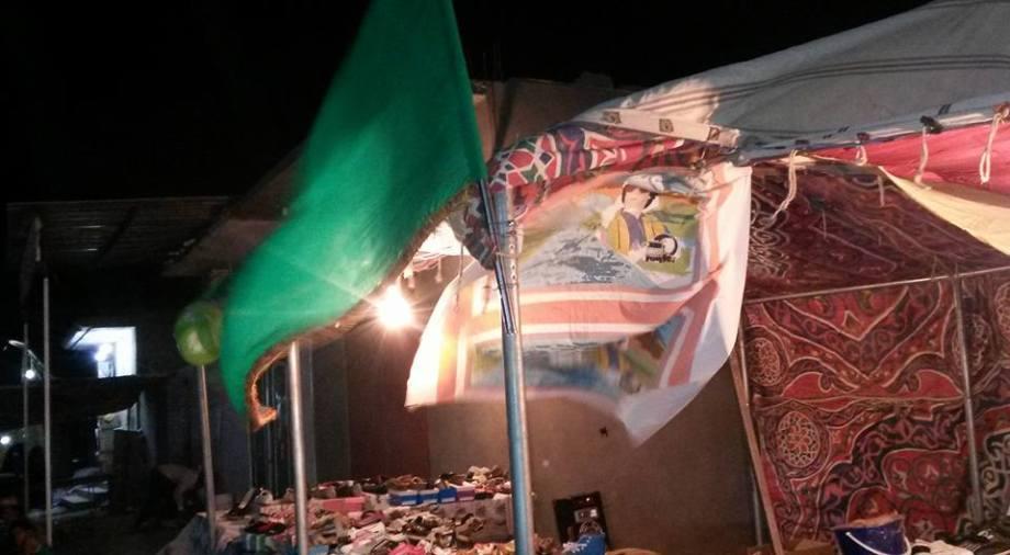 Green Flag  and Great Jamahiriya paraphenelia at Dealer in BARAK CHAT'AI