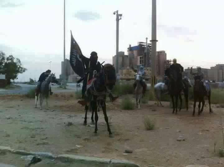 'DAASH' on horseback in Benghazi, 3
