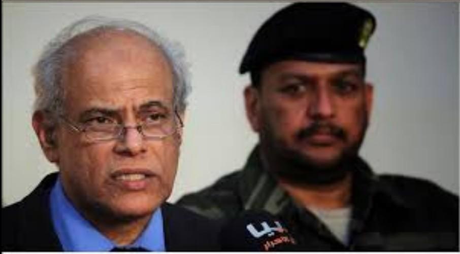 Libyan Justice Minister Salah Mirghani and follow-up