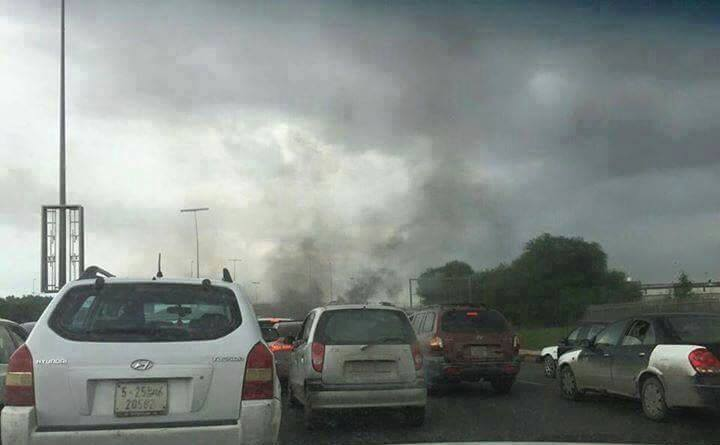torching tires at Green Bridge in Tripoli, 1