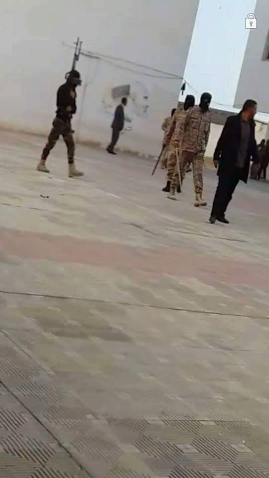 Group of masked intervention at 'Abu Issa Institute', Corner Tripoli, 1