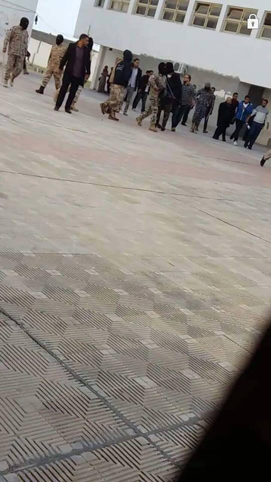 Group of masked intervention at 'Abu Issa Institute', Corner Tripoli, 2