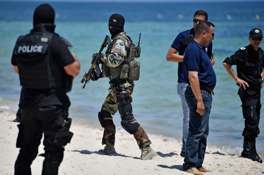 SOUSSE, TUNISIA - JUNE 29: Armed guards patrol Marhaba beach during a visit by British Home Secretary Theresa May at the scene where 38 people were killed on Marhaba beach last Friday, on June 29, Sousse, Tunisia. British Prime Minister David Cameron has said it has emerged that the British death toll in the Tunisian attack will rise above 30. (Photo by Jeff J Mitchell/Getty Images)