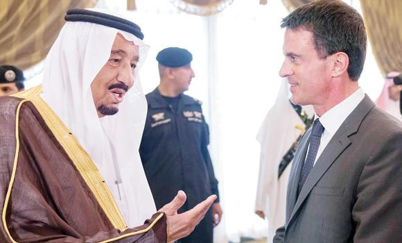WAHHABI-SAUDI KING SALMAN and French premier Emmanuel Valls review ties