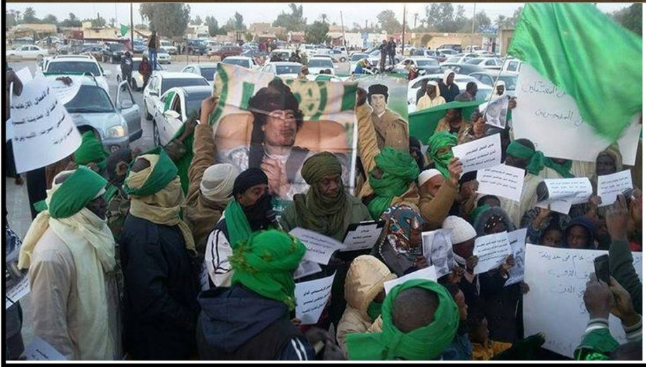 people of LANGUAGES (SOUTH LIBYA) carrying pictures of our LIVING commander