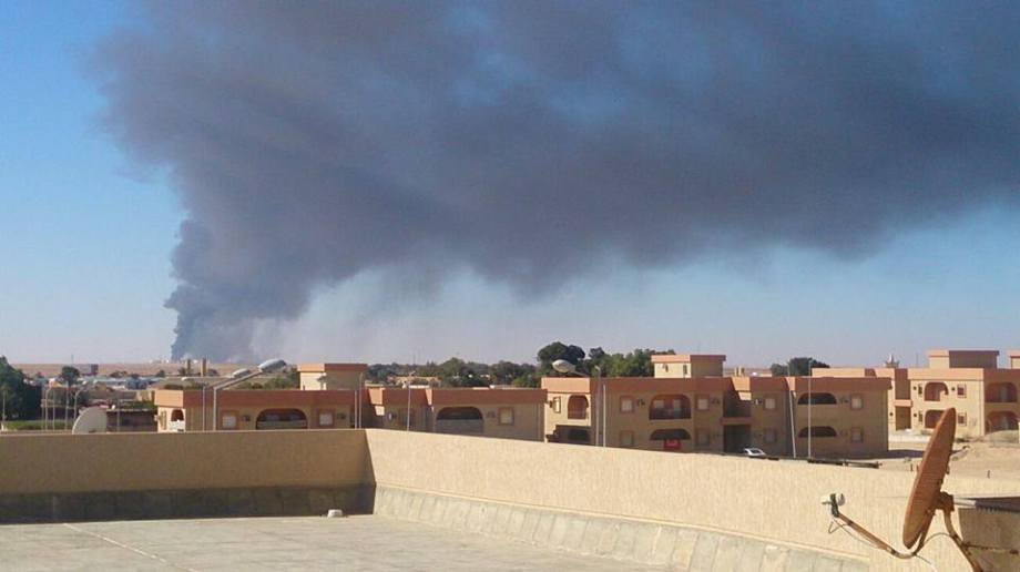 Port Sidra oil tanks on fire (image taken from the center of Ras Lanauf )
